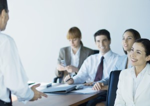 Business colleagues in meeting, smiling